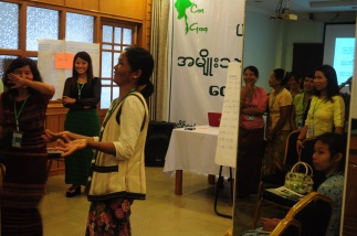 Women from Kachin, Kayah and Chin share a joke at the FFF
